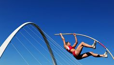 April Bennett of the U.S. competes in the women's pole vault with the Millennium Bridge in the background during the Great North City Games in Newcastle upon Tyne, England