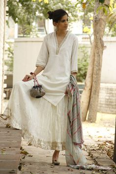 Nice white summary dress. Casual ethnic. Description by Pinner Mahua Roy Chowdhury.