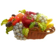 A delightfully fun vintage painted celluloid fruit basket brooch. #vintage #jewelry #accessories #brooch