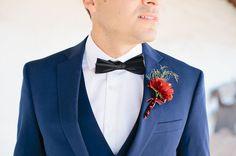 blue suit groom with crimson boutonnière