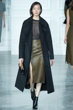 Jason Wu Fall 2015. Love the sheer navy top with the crocodile skirt and the long coat. It's a classy and modern look.
