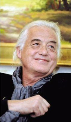I love this picture of Jimmy Page. His eyes have a happy sparkle...JW