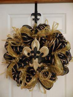 New Orleans Saints themed deco mesh wreath.