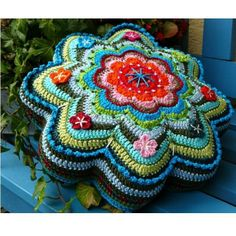 Pattern for this beautiful pillow is available~Different examples show how the same pattern makes a totally different flower when using different embellishment techniques. This pattern includes two instructions:     •entirely crocheted flower pillow    •round pillow made from fabric with a crocheted flower top