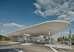 Stuttgart architecture studio Metaraum has completed a bus station in the German city of Pforzheim, featuring curving canopies that swoop up and over waiting areas.