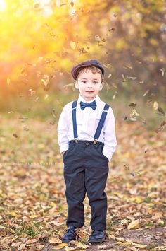 Child's outdoor fall photography. Wedding ring bearer. Fall wedding. Outdoor wedding. Children's session. Fall session. Falling leaves. Leaf crafts. Leaf overlay. Suspenders for boys. Wedding suspenders. Chadron Nebraska. Http://www.facebook.com/BReinphotography
