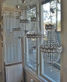 no such thing as too many chandeliers... i would have loved those on the window looking out on my deck!