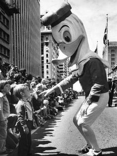 A giant duck either talks to (or terrifies) a small boy at the John Martin's Christmas Pageant in 1977