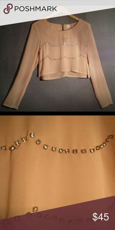 New- Peach Sorbet Rhinestone Scalloped Top- LARGE ** NO TRADES WHATSOEVER **  Chiffon long sleeve semi-sheer blouse will glam up any outfit. Crystal clear stones in a scallop shape adorn the front. Pull on style with half length gold zipper at nape if neck. BRAND NEW, NEVER WORN LARGE  I work in L.A as a wardrobe stylist for film and television. All my items are authentic and come from high end boutiques or stores. Cover Stitched Tops