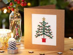 Start stitching in time for the festive season with our cross stitch Christmas tree card complete with sparkly star and shimmering beads