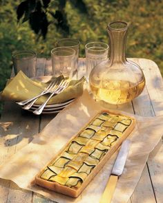 Diced yellow summer squash, zucchini, and leeks are tossed in butter, seasoned, and topped with Gruyere cheese. The mixture fills a flaky tart crust and is topped with more squash, woven in a lattice pattern.
