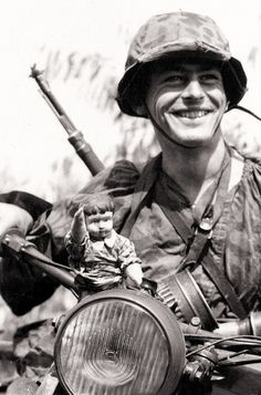 German soldier with a Nazi toy!