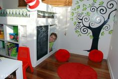 Awesome kids bed with storage shelves and a cubby underneath. Also love the tree wall decal.