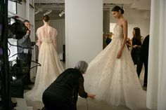 "Prepping the models for the runway at the Amsale Spring 2016 show - Left: ""Elaine"" gown with hand beaded jacket Right: ""Nava"" gown"