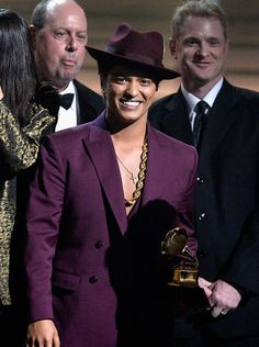 Bruno Mars accepts the Record of the Year award for 'Uptown Funk' at The Grammys!