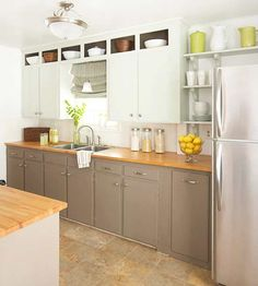 Paint Select Cabinets - If you don't want to paint the entire room, consider painting just a section of cabinets. For instance, painting three or four cabinets on a short run will create the illusion of a built-in hutch. Or create variation by painting the lower and upper cabinets contrasting colors.