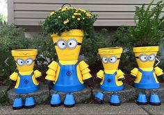 Minions made from terra cotta flower pots. Aren't they adorable! Unknown origin.