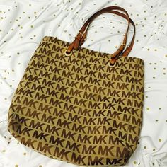MK Monogram Tote Purse is still in great condition just looking for something new. Has a bit of wear and tear on the handle but other wise looks great. Material is very durable. MICHAEL Michael Kors Bags Totes