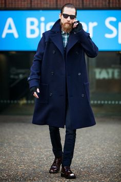 Justin O'Shea, looking elegant in blue coat, jeans, burgundy shoes and plaid shirt