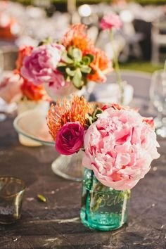 Pink and orange flowers in teal mason jars // colorful wedding centerpieces Colorful Wedding Centerpieces, Rustic Wedding Centerpieces, Wedding Flower Arrangements, Wedding Table, Floral Arrangements, Wedding Flowers, Wedding Decorations, Wedding Ideas, Budget Wedding