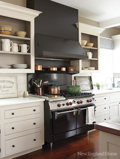 Cabs in Benjamin Moore's Briarwood, range hood is stainless steel, painted black.  Love that they painted the range hood!