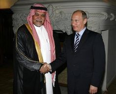 Prince Bandar bin Sultan (L), Secretary-General of Saudi Arabia's National Security Council, shakes hands with Russia's Prime Minister Vladimir Putin in Moscow July 14, 2008. RUSSIA/RIA Novosti/Alexei Druzhinin/Pool