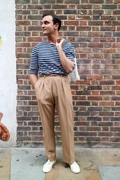 We photograph James on the streets of London wearing a stripe t-shirt and high waisted pleat trousers.