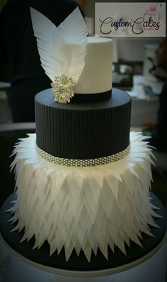 Wafer Paper Feather & Embossed Fondant Diamante Brooch Cake /Custom Cakes by Brooke. East Gosford ,New South Wales ,Australia The 'feather' styled bottom tier was made with hand cut wafer paper. Art Deco Cake, Cake Art, Beautiful Wedding Cakes, Beautiful Cakes, Fondant Cakes, Cupcake Cakes, Black White Cakes, Wafer Paper Cake, 40th Birthday Cakes