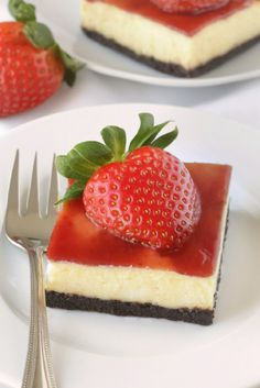 Strawberry white chocolate cheesecake bars have a chocolate cookie-like crust and strawberry jam topping. These are so good!  Recipe contains a gluten-free option.