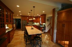 Open Concept Kitchen, Large Kitchen Island, Breakfast Nook, Large tile floor, china hutch, bead board ceiling, Copper farmers sink, peninsula island seating,