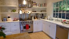 open shelving in kitchen of the guest house. saves money. like the stainless behind the stove too.