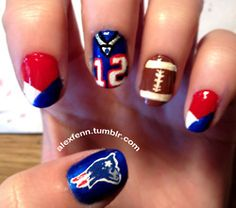 football nail art.. not diggin the team but they would be great for high school football games :)
