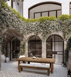 Stone combined with white brick and black frame arched doors and windows is my new dream after seeing this beauty by MHNDU Architects,… Design Exterior, Interior And Exterior, Facade Design, Outdoor Spaces, Outdoor Living, Arched Doors, Arched Windows, My Dream Home, Future House