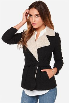 """It's the season of shearling, and the Jack by BB Dakota Smith Beige and Black Coat is a find that shouldn't pass you by! Soft black boucle introduces amazingly soft faux shearling that accents the collar, notched lapels, and interior edge of this wrap coat. A single button closure and tying sash belt create a fitted waistline with welted pockets at front. Fully lined. Model is 5'8"""" and is wearing a size X-small. Self: 85% Polyester, 5% Acrylic, 5% Wool, 5% Viscose. Trim: 100% Polyester…"""