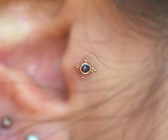 Tragus piercings are just too cute. Especially with gold and opal in them!