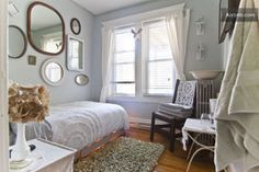 Love the mirrors and the chenille bedspread