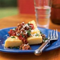 Polenta with Bolognese Sauce | MyRecipes.com USE ANOTHER TOPPING AND CRISP THE POLENTA ON GRILL AS IN COMMENTS