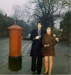 Circa late 1967. A winter's afternoon and Paul photographed with a fan by a Victorian post box