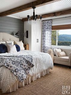 More than a little effort was put into this guest bedroom. Luxurious bedding would have sufficed, but the homeowners went all out, adding a quaint sitting space by the large window. Textural jute carpeting, slate shiplap walls, and reclaimed wood beams rest below a beaded-board ceiling. A crystal and iron chandelier provides the finishing touch this guest room deserves.