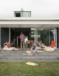 The Parsonson Residence, a modern beach house in New Zealand, features slide-away doors and a large patio perfect for sunbathing and looking out toward Kapiti Island. Love these stepped patios: Deck Steps, Porch Steps, Wood Patio, Beach Shack, Beach Cottage Decor, Lofts, Beach Cottages, Beach Houses, Porches