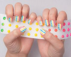 If you think this dotted mani looks way too tough, you're in for a treat (no pun intended — okay, just a little bit intended). This bright mani doesn't require any complicated tools or techniques. All you need is a few Q-tips and a little patience! Click through for a tutorial and more summery and candy-inspired nail art designs.