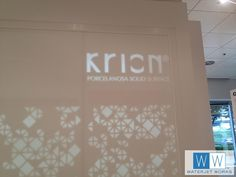 Closeup of the Krion logo in the back-lit Krion wall for Porcelanosa Dallas