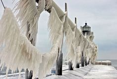 """This is the St. Joseph Lighthouse on Lake Michigan. Today, it is encased in ice as the Midwest is hit with a """"polar vortex"""", causing wind chills to reach -50 degrees. January 2014 Kh"""