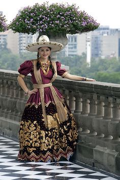 vestidos de charras, this is a dress they use for the charreada sport. This is a version that the women would wear.