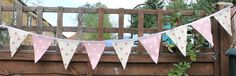 Dotty oilcloth bunting - see our dotty range at: http://www.justwipe.co.uk/vinyl-coated-tablecloth-range/spot-vinyl-coated-tablecloths-sl/