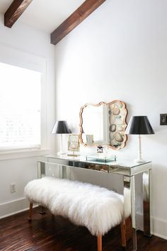 """This is a favorite moment of Kristen's: """"The vanity in the bedroom is so lovely. I have never designed something like this before. I love the mix of metals and and the Mongolian fur bench... so glam!"""""""