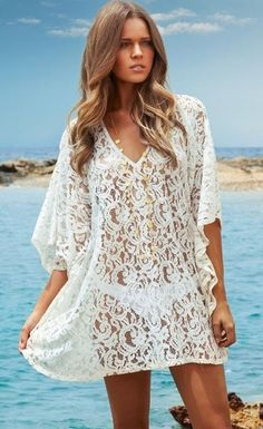 """Short delicate lace beach kaftan dress designed with draped wing sleeves and a """"V"""" neckline which will give you maximum style and comfort and complete your beach look. Set your sexy beach style free, this lace dress is amazing to slip overlay your bikini or one-piece swimwear, and it worth to check out without trying!"""