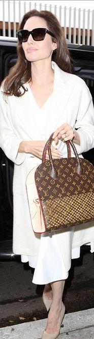 Angelina Jolie: Sunglasses – Saint Laurent Earrings – Dana Rebecca Designs Purse – Louis Vuitton