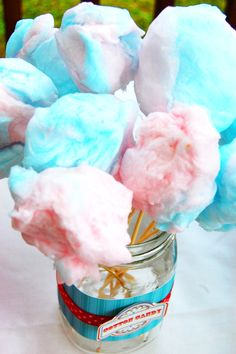 birthday party table ideas, cotton candy on a stick for a circus or carnival theme