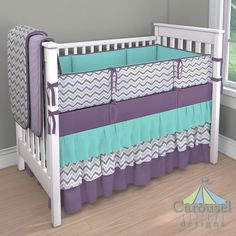 Crib bedding in Solid Aubergine Purple, Solid Lilac Minky, Lilac and Slate Gray Chevron, Solid Teal. Created using the Nursery Designer® by Carousel Designs where you mix and match from hundreds of fabrics to create your own unique baby bedding. #carouseldesigns